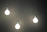 Glowing light bulbs on concrete wall - 245787882