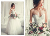 Close up wedding portrait of beautiful woman in fashionable elegant dress with wedding bouquet