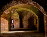 The brick walls covered in moss and corridors of Fort Point, a tourist attraction and old fortification in San Francisco, CA, USA - 245814061