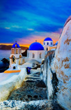 Picturesque view of Old Town Oia on the island Santorini, white houses, windmills and church with blue domes, Greece - 245817001
