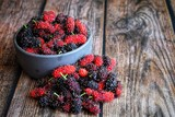 Close up of mulberry on wooden table