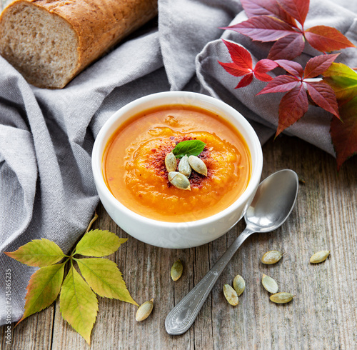 Bowl of pumpkin soup - 245865235