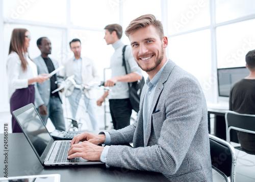 Leinwandbild Motiv programmer is testing the laptop in the office