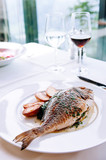 Grilled sea bream fish with butter sauce and baked potatoes - 245869282