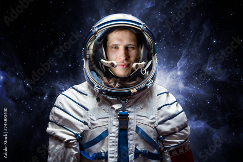 close up portrait of young astronaut completed space mission b. Elements of this image furnished by nasa - 245881400