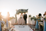 Bride and groom at a wedding ceremony - 245886600