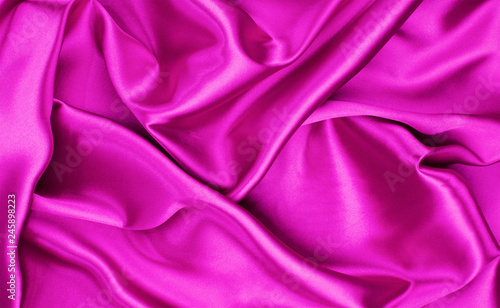 Closeup of rippled purple silk fabric - 245898223