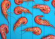 Shrimps background on wood - 245922042