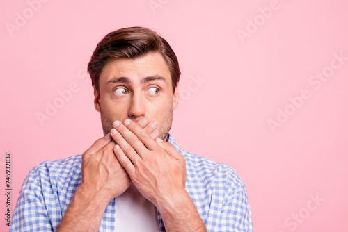 Leinwandbild Motiv Close up photo of beautiful amazing pretty he him his handsome oh no hide mouth by arms do not like rumors not speak wearing casual checkered plaid shirt outfit isolated on rose background