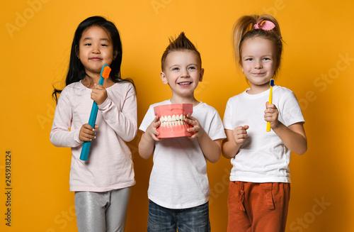 fototapeta na ścianę dental hygiene. happy little cute children with toothbrushes.