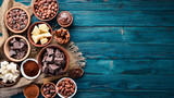 Chocolate, cocoa and cocoa beans on a blue wooden background. Top view. Free copy space. - 245945293