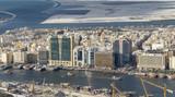 DUBAI - DECEMBER 2016: Buildings along Dubai Creek on a sunny day. Dubai is the major city of United Arab Emirates