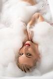 Erotic young blonde in foam bath