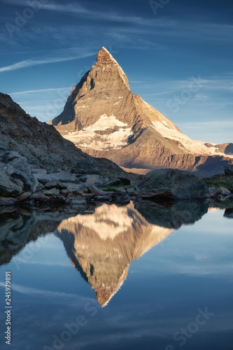 Matterhorn and reflection on the water surface during sunrise. Beautiful natural landscape in the Switzerland. Matterhorn, Zermatt, Switzerland-Image - 245979891