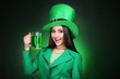 St. Patrick's Day. Beautiful woman wearing green hat with beer