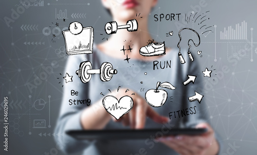 Fitness and diet with business woman using a tablet computer - 246029695