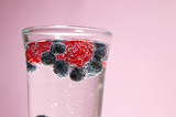mineral water with blueberries and raspberries