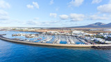 Aerial view of Playa Blanca Rubicon marina, with sailing boats, yacht, holidays homes, volcanic mountains in the background  Lanzarote, Canary Islands, Spain . - 246034613