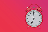Old red clock on a red, purple gradient background shows 7 hours