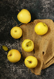 ripe yellow organic apples on a wooden table - 246096416