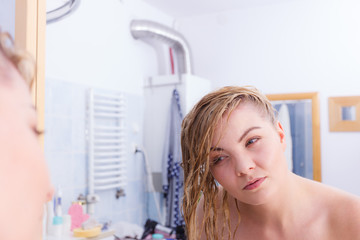 Woman with wet blonde hair