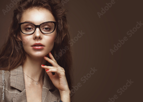 Beautiful girl in stylish clothes with glasses for vision and red sexy lips.