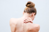 Young woman having pain in the back and neck. Health-care Concept. - 246172202