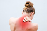 Young woman having pain in the back and neck. Health-care Concept. - 246183412