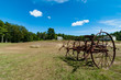 old plough on a farm landscape in Maine, USA