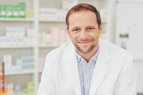 Leinwandbild Motiv Smiling friendly pharmacist in a drugstore