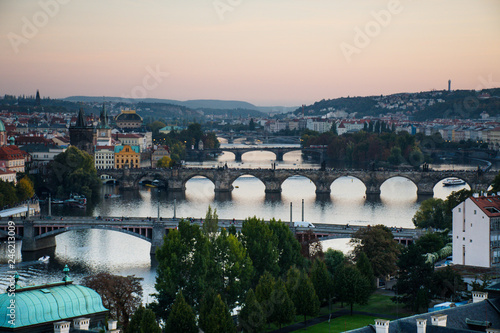 Prague cityscape with national theatre and the river
