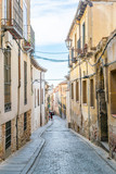 View of a narrow street at old town of Segovia, Spain