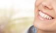 Leinwandbild Motiv Woman teeth and a dentist mouth mirror on background