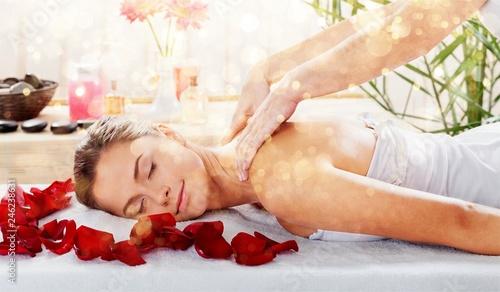 Leinwandbild Motiv Beautiful young woman relaxing with massage