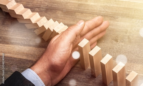 Hand of young business man stopping wooden - 246240468