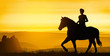 Girl rides on the hills under a golden sunset