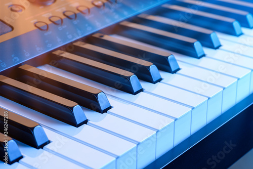 Digital synthesizer piano keyboard keys.Black &white piano key board in closeup.Play electronic piano keyboards.Professional musician sound recording equipment. - 246247208