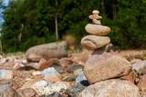 Zen pyramid of stones on seashore.Concept harmony and balance,spa and yoga