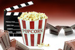Leinwanddruck Bild - Popcorn, movie clapper and film strips.  Cinema concept image
