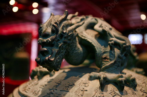 The decor element is the handle of a bell in the form of a dragon. Big Bell Temple. Beijing, China.