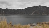 Quilotoa water filled calera volcanic lake water is blown by wind - 246293441