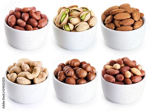 fototapeta na ścianę Bowl with pistachios, hazelnut, peanuts, almonds, cashews isolated on white background.