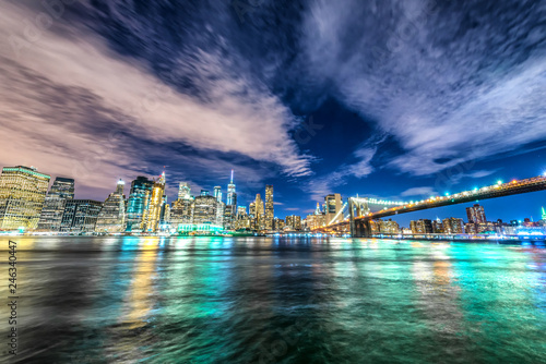 Skyline of Manhattan and Brooklyn bridge, night view - 246340447