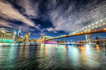 Skyline of Manhattan and Brooklyn bridge, night view