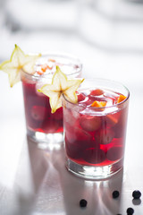Delicious red sangria cocktail with fruits