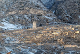 The ruins of an ancient mountain village with many fences built of stones - 246353460