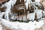 Large frozen icicles on site of waterfalls in mountainous area