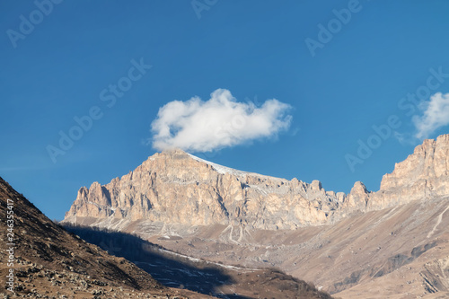 Mountain landscape with views of mountain ranges and passes with clouds