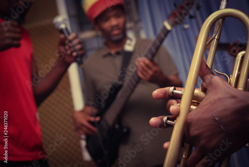 Musician playing trumpet at band rehearsal - 246371020