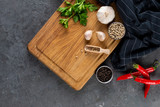 Herbs and spices at dark slate table. Parsley, dill, garlic and pepper. Ingredients for cooking, copy space, top view - 246385060